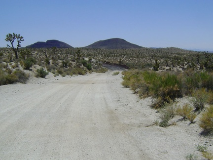 Riding south from Tank 3 on Aiken Mine Road, the road is slightly sandy with occasional volcanic debris