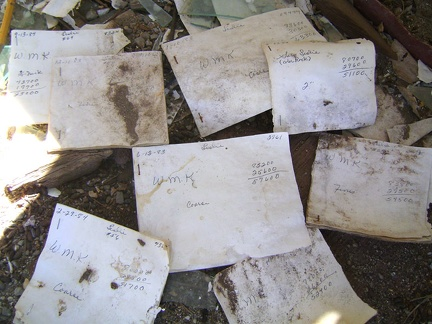 On the floor of the weigh station at the abandoned Aiken Mine lay old receipts and records bearing dates from the 1980s