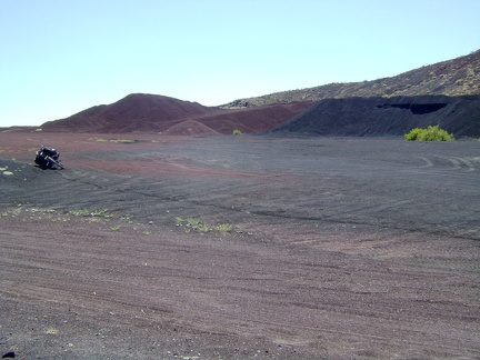 I return to the 10-ton bike and ride southwest across the red earth away to exit the Aiken Mine area