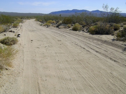 I often find myself riding in the furthest-left tire track on the road to avoid the bumpy washboard surface
