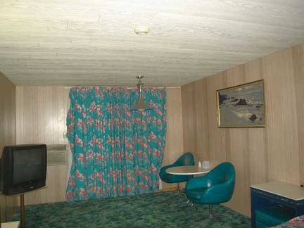 Pretty curtains and dinette suite in my room at the Royal Hawaiian Motel