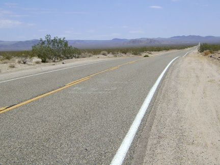 The first 10 miles of Kelbaker Road upon leaving Baker is long and straight and rises from 925 feet to 2000 feet