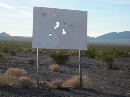 An old sign announcing a proposed toxic waste dump here at Broadwell Dry Lake has been appropriately well shot-up