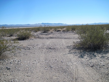 I continue hiking down the old road toward Broadwell Dry Lake and see some of my bicycle tracks from last night