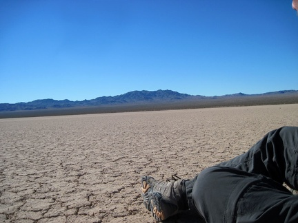 I sit down for a few minutes on the hard, crackled surface of Broadwell Dry Lake