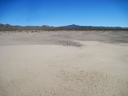 I reach the eastern shore of Broadwell Dry Lake and begin the hike up the fan toward the Bristol Mountains