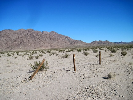 "On the fan are a few fence posts, also from ""JHJ claims,"" like the ones on the other side of Broadwell Dry Lake"