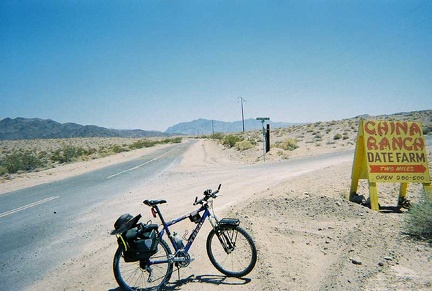I ride up the Old Spanish Trail Highway's gentle hill, which leads out of Tecopa toward the Kingston Range