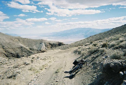 I park the bike and go for a walk up the big hill to my right to take in the views of Death Valley below