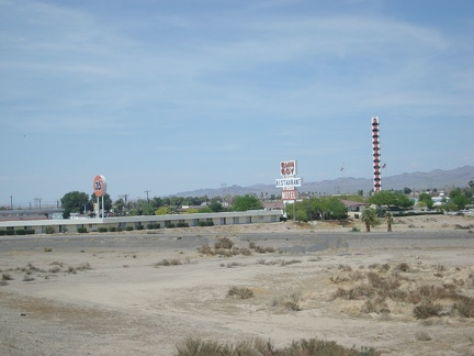 "Baker, California has a sort of skyline with its ""tallest thermometer in the world"" and its motel and fast-food signs"