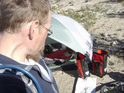 Back at my campsite near Kelso Dunes for a few minutes, I stuff a few items in my saddlebags for the ride to Coyote Springs
