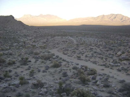 I leave the Coyote Springs stream and climb up one of the low rocky hills along the old road on the way back to my bike