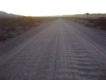 In the last vestiges of daylight, I rattle four miles down the Kelso Dunes Road washboard back to my tent