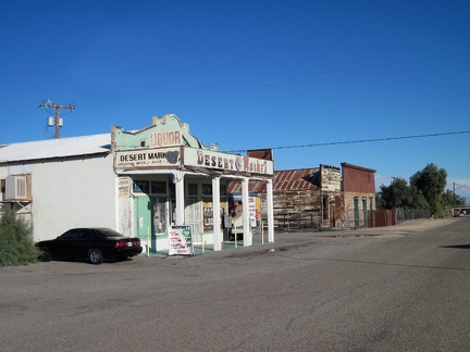 A small grocery store is the dominant living feature on Daggett's main street