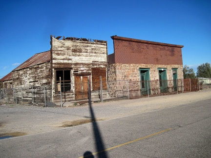 These two old commercial buildings in Daggett have been fenced off, perhaps with the hope of preserving them