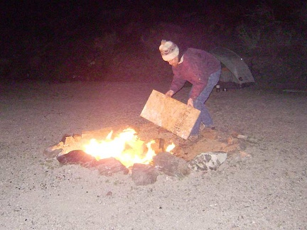 I add another piece of junk plywood to the fire