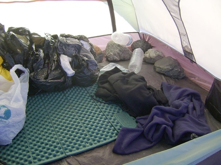As I pack the tent's contents into my saddlebags, I remove the big rocks I placed inside the tent to keep it from blowing away