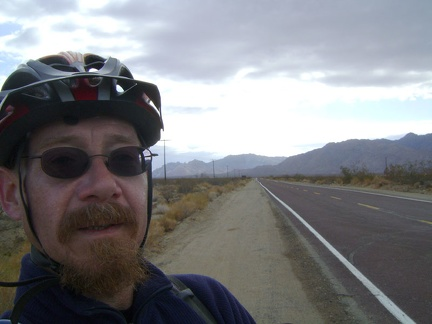 At the end of Kelso Dunes Road, I start riding down the paved Kelbaker Road, with the Granite Mountains behind me