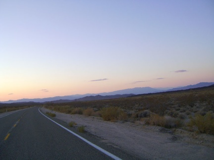 Sunset fades into dusk, then darkness joins me while I enjoy the final 12 miles of the ride into Baker