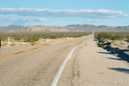 I ride into Mojave National Preserve up Kelbaker Road away from Baker, California