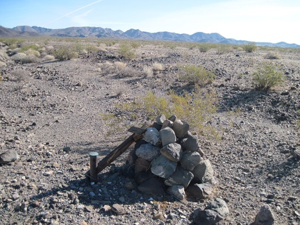 "Out here ""in the middle of nowhere"" in the Kelso Dunes Wilderness Area is a rock cairn with something attached to it"