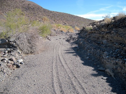 "I continue hiking up ""South Broadwell Wash,"" following an old set of dirt-bike tracks"