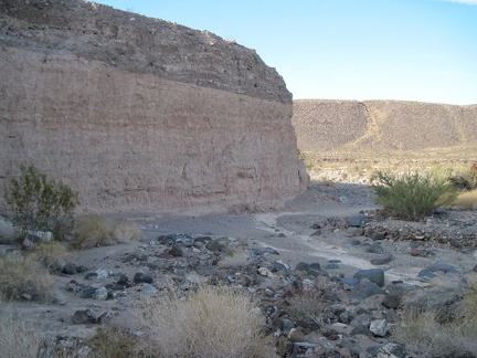 "Erosion in ""South Broadwell Wash"" exposes earth layers that would otherwise be hidden"