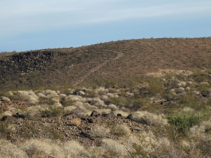 As I continue my return hike, I notice an old road climbing a hillside, which I didn't notice while hiking up the wash