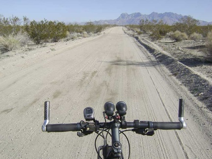 I ride back up the road 1.25 miles to the Kelso Dunes trailhead