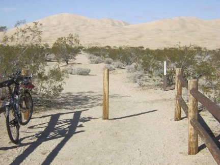 I lock the bike to the fence at the Kelso Dunes trailhead