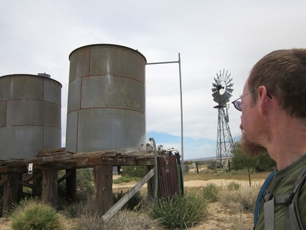 A couple of old water tanks and a windmill sit near Ivanpah Road at the OX Ranch site