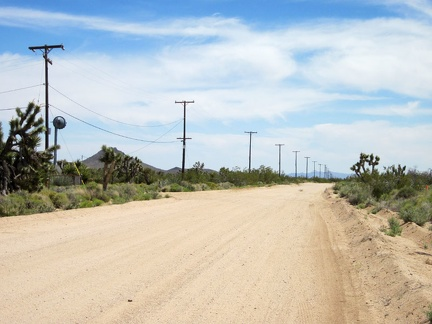 I know I'm getting close to the junction of Ivanpah Road and Cedar Canyon Road when I see power lines along the road