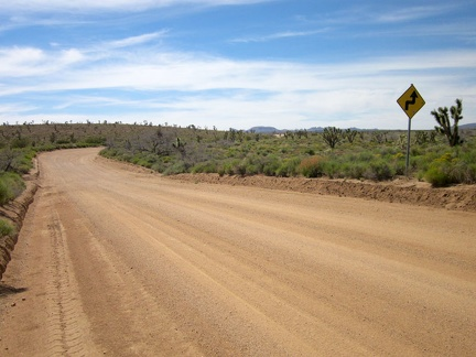 Long stretches of Cedar Canyon Road are perfectly straight, but there are some curves and even a few 90-degree corners