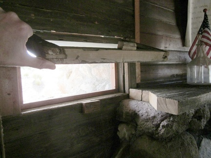 The little windows that flank the fireplace in the Bert Smith rock house are hinged on the top