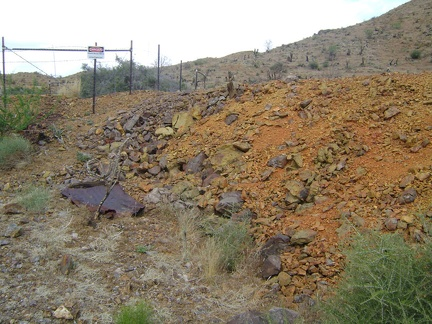"I reach the orange tailings pile at Columbia Mine and see a ""danger"" sign"