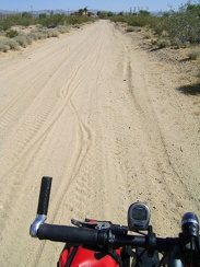My tires hiss gently as I ride through the sand at the bottom of Cornfield Road toward Kelso Depot