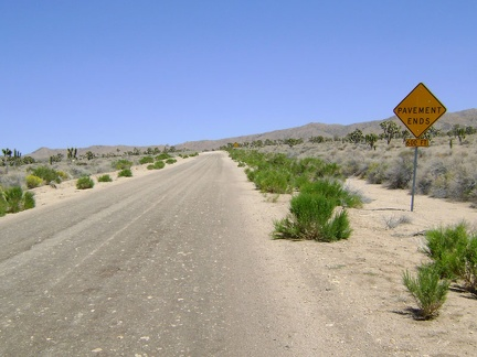 "Cedar Canyon Road's famous ""pavement ends"" sign"