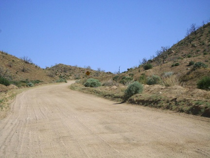 Black Canyon Road's grade here ranges from three to seven per cent, with a bit of loose sand on a hard washboard surface