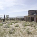 Behind the main house at Death Valley Mine are an old corral and a big shed