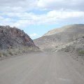 Ivanpah Road rises over the pass and begins its slow descent down into the valley