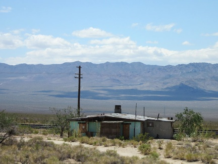 As I approach the train tracks, I pass the old Ivanpah General Store