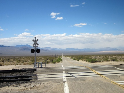At the Ivanpah Road railroad crossing, I make a right turn toward Nipton on the dirt road (Nipton-Moore Rd) that hugs the tracks