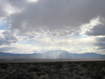 It looks like a few rainy patches are moving around out in the middle of Ivanpah Valley