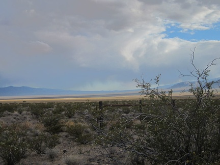 I keep looking back at the murky clouds over upper Ivanpah Valley toward Cima and the New York Mountains