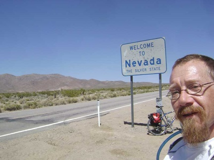 "Three miles up the hill of Nipton Road, I reach the ""Welcome to Nevada"" sign that makes a perfect tourist photo"
