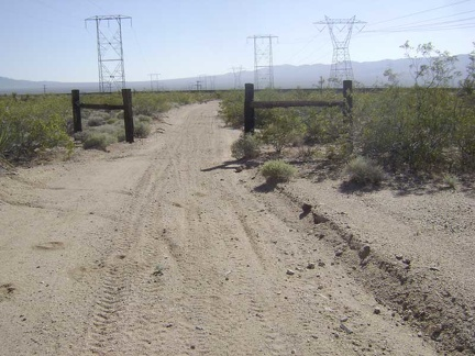 At the bottom of the hill, the power-line road passes through an old ranch fence