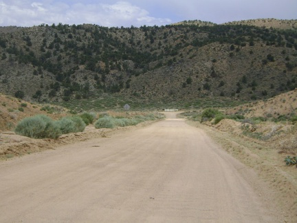 Next, I ride two miles down the washboarded Black Canyon Road, which ends at a T-intersection in Cedar Canyon