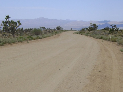 The road rises out of Cedar Canyon to look out over Kelso Valley and I turn right here on Death Valley Mine Road