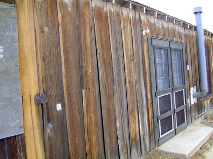 The heavily weathered board-and-batten exterior of the Cima store is in need of restoration work