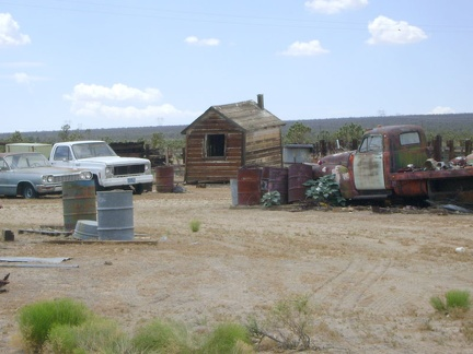 More old motor vehicles, and another crooked shed, behind the Cima Store, Mojave National Preserve
